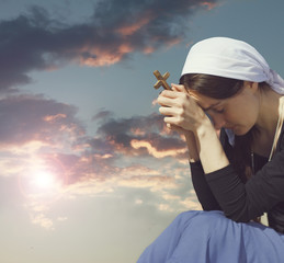 Photo of praying woman