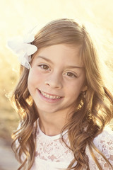 Beautiful hispanic little girl backlit portrait