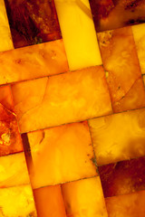 Closeup of golden amber mosaic as background or texture. Gem.