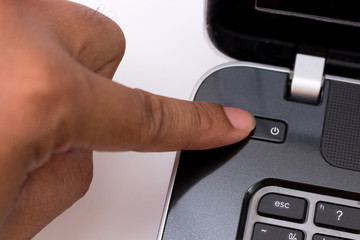 finger push on power button