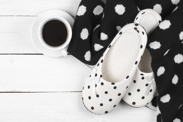 Feminine slippers, knitwear and coffee