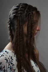 Profile portrait of fashion female brunette with braids