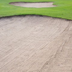 sand bunker and green grass of golf course