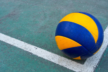 Old volleyball on a dirty court