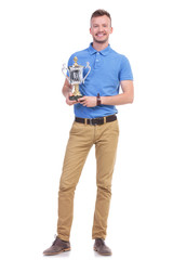 casual young man with a trophy