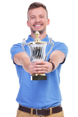 casual young man holds his trophy