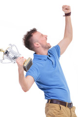 casual young man shouts with trophy in hand