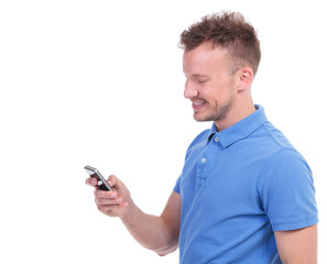 casual young man smiles while texting