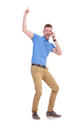 casual young man points up while on the phone