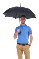 casual young man with umbrella in hand