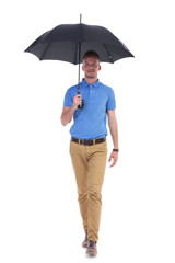 casual young man walks to you with umbrella