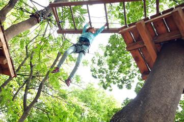 girl  in a climbing adventure activity park