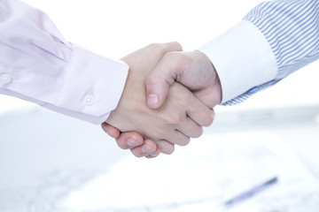 Men and women who are shaking hands