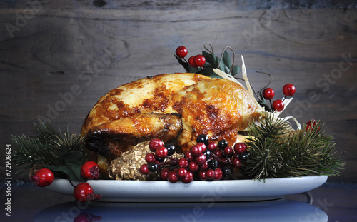 Festive Thanksgiving or Christmas roast turkey chicken  Photo by millefloreimages