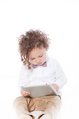 Cute Curly Kid Busy with Ipad Tablet