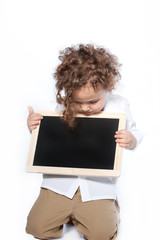 Young Boy Looking Down at Blank Slate Chalkboard