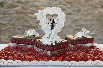 Wedding Cake Topped with Bride and Groom Figurines