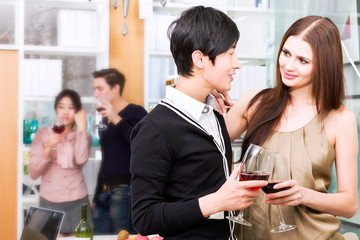 Friends toasting with wine at party