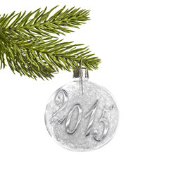 2015 on a white silver Christmas ball hanging on a tree