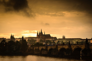 Vltava river and a Prague Castle at sunset ,Czech Republic .