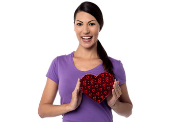 Smiling woman with heart shape gift box