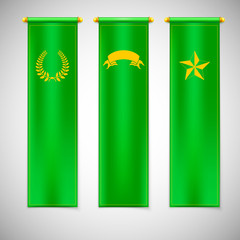 Vertical green flags with emblems.