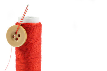Spool of Red Thread with Needle and Button