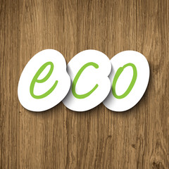 Eco sign on wooden background