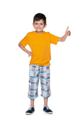 Smiling young boy with his thumb up