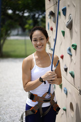 Asian Chinese Woman in outdoor rockclimb