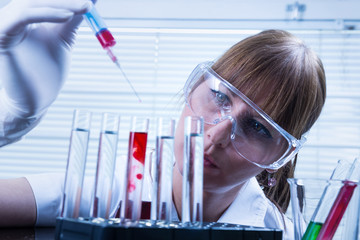 Laboratory, The Woman in the lab experimenting.