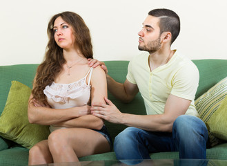 Man asking for forgivness from woman