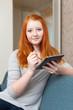Teenager girl uses electronic book