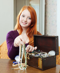 teen  chooses jewelry in treasure chest