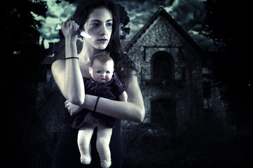 Teenage girl with knife and doll in front of a spooky house