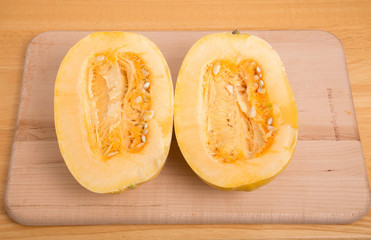 Halved Spaghetti Squash on Cutting Board