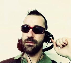 DJ playing music with headphones