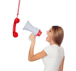Blonde woman shouting through a phone hanging with a megaphone