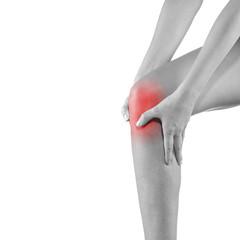 Woman holding injured knee.