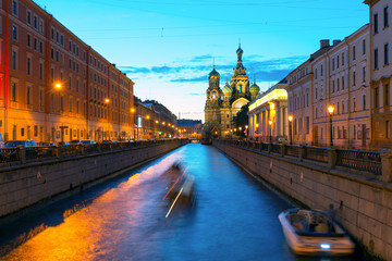 Tourist boats sail to Church of Savior on Blood, St Petersburg