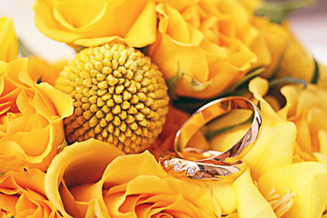 wedding rings wedding flowers yellow