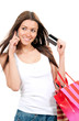 woman with shopping bags credit card in hand talking on cell
