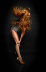 beautiful woman posing dancing in casual cloth with windy hair