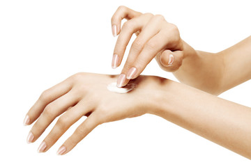 moisturizer cream on female hands on a white background