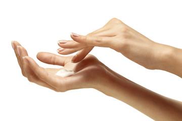 Moisturizer cream on beautiful female hands isolated