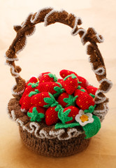Knitted strawberry in basket