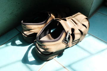 Old brown leather sandals