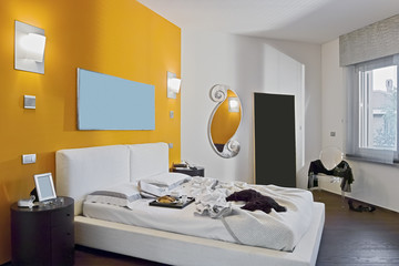 interior view of a modern bedroom with orange wall