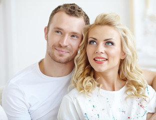 Young love couple smiling in the apartment