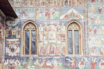 detailed imaged of painted wall and windows of Sucevita Monaster
